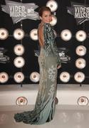 http://img271.imagevenue.com/loc121/th_393538199_Miley_Cyrus_1411_122_121lo.jpg