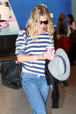 Сиенна Миллер, фото 2852. Sienna Miller arrives at Heathrow Airport - July 31, foto 2852