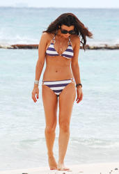 Ali Landry ~ On the beach - January 7, 2011 (x9)